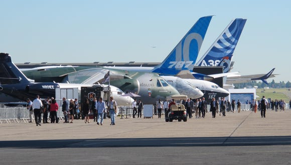 Visitors check out the line-up of planes on display