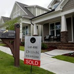 A sold sign is displayed in the yard of a home in the Briar Chapel community in Chapel Hill, N.C.