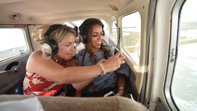 """Penny Tranchilla (left), of Vero Beach, and her friend Vicky Dominguez, of Mexico, admire the view of the Atlantic Ocean east of the Sebastian Inlet while on Treasure Coast Seaplanes tour of the Sebastian Inlet and Blue Cypress Lake from a Cessna float plane on Friday, Oct. 6, 2017, over Indian River County. """"I love seeing the world from up high, it's a different perspective of our community,"""" Tranchilla said. """"I think people come here for the beach, and there is so much more beauty to be found."""""""