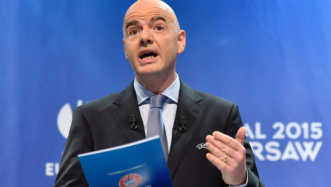 UEFA secretary general Gianni Infantino speaks during the draw for the UEFA Champions League  semifinal matches on April 24, 2015.
