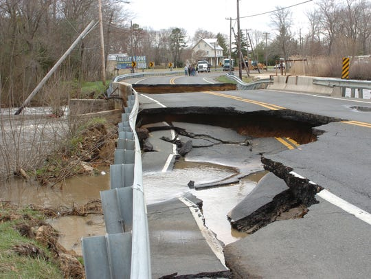 File: Looking west, Landis Ave cracked and sunk when