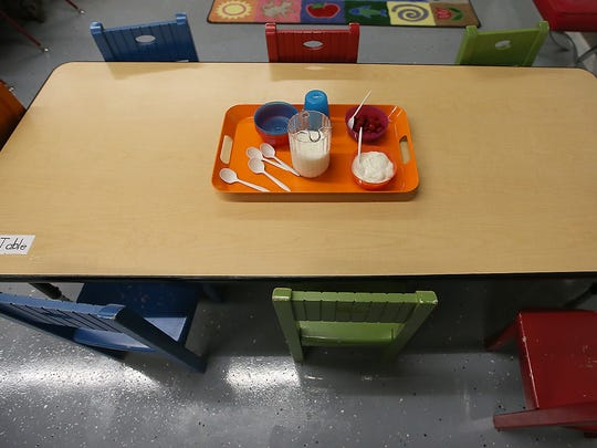 A tray with yogurt and raspberries awaits the hungry youngsters as snack-time begins at Treetop Village Early Learning Center in Bremerton.