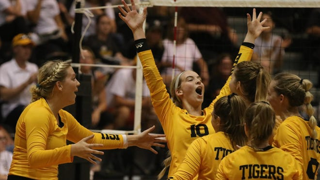 Delaney Humm (10) and members of the Fort Hays State volleyball team celebrate a point during a match in 2019. The Tigers will open up a spring slate this weekend at Gross Memorial Coliseum.