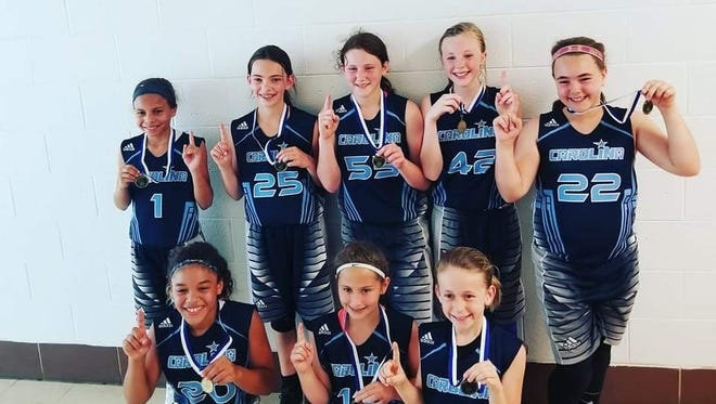 Three girls basketball teams with the Team Carolina Asheville AAU organization brought back championships from last weekend's Marriott Summer Slam tournament in Raleigh.
