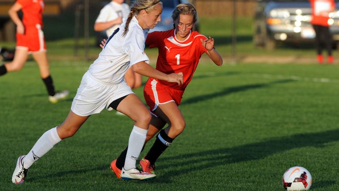 River View's Danielle Muhleman and Coshocton's Skylar Hasseman battle for possession during River View's 6-0 victory over Coshocton on Thursday in Warsaw.
