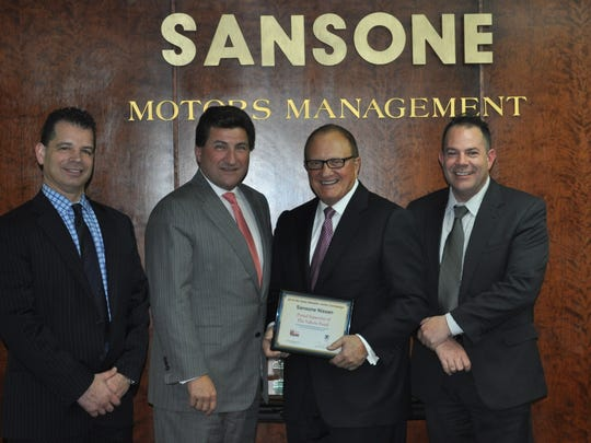 Dave Salsido the vp of operations, John Pugliese, president, Paul Sansone and Travis Walker parts and service director