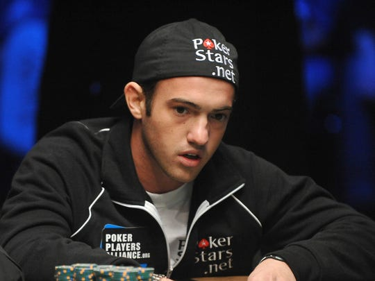 A picture taken on November 7, 2009 shows American Joseph (Joe) Cada organizing his chips during a hand at the final table at the 2009 World Series of Poker (WSOP) at the Penn & Teller Theater at the Rio Hotel in Las Vegas. The 21-year-old college dropout won the World Series of Poker early on November 10, 2009 completing the biggest comeback in the tournament's history to earn a 8.5 million dollar jackpot.    AFP PHOTO / Robyn Beck (Photo credit should read ROBYN BECK/AFP/Getty Images) ORG XMIT: US-GAME-