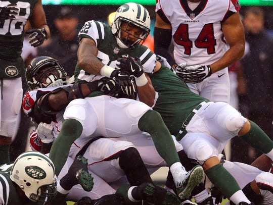 New York Jets running back Matt Forte is tackled by