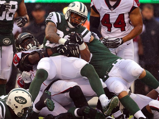 New York Jets running back Matt Forte is tackled by Atlanta Falcons defensive tackle Grady Jarrett during the first quarter at MetLife Stadium.