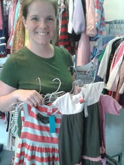 Wendy Lemon of Royal Oak found clothing for her daughters at Piccolo Penguin, a new children's apparel resale shop.