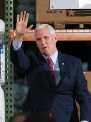Vice President Mike Pence waved at supporters following remarks at the Trane Parts and Distribution Center in Louisville.