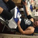 ULM tight end Alec Osbourne donates blood inside Malone Stadium on Thursday.