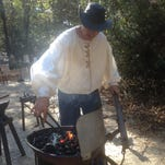 Chuck Averett, a member of the Gulf Coast Blacksmith Association, works on an authentic 1860s forge during Forge Day at Crosby Arboretum in Picayune. The event will be held from 10 a.m.-2 p.m. Saturday.