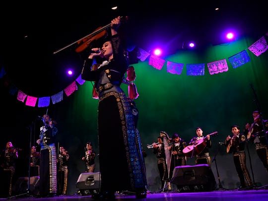Members of Mariachi Sol Azteca perform during Fiesta at the Paramount April . The mariachi group is from the Grand Prairie Fine Arts Academy and performed at the Paramount Theatre with Ballet Folklorico del Big Country in a celebration of Mexican culture.