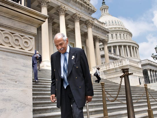 Rep. John Conyers, D-Mich., walks down the steps of