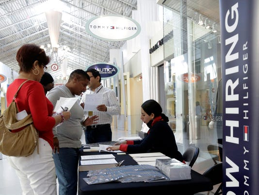 Nov. job gains surge to nearly 3-year high