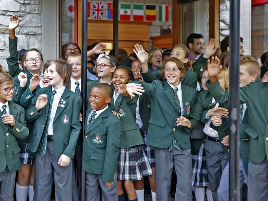 St. Richard's students wave goodbye to eighth-grader