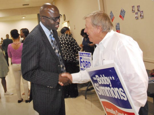 July 9, 2018 -  Bartlett alderman Bobby Simmons (right) welcomes atendees during a recent election meet and greet. Simmons is vieing for the position of juvenile court clerk aganst Memphis City Council member democrat Janis Fullilove. (Stan Carroll/For the Commercial Appeal)