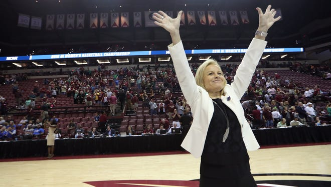 FSU Head Coach Sue Semrau celebrates with the fans after the Seminoles' 91-49 win against Arkansas Little Rock during their NCAA matchup at the Tucker Civic Center on Saturday, March 17, 2018.