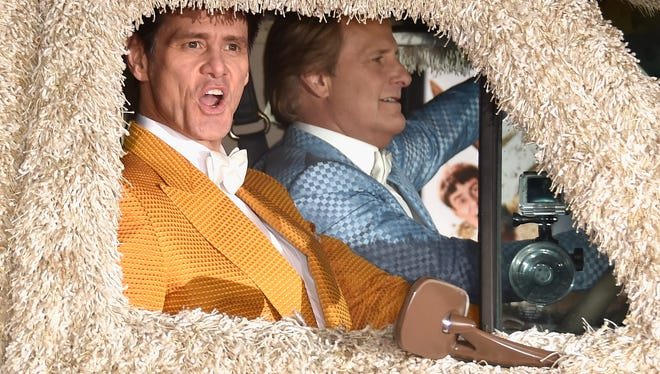 "File photo taken in 2014 shows actors Jim Carrey (L) and Jeff Daniels arriving at the premiere of Universal Pictures and Red Granite Pictures' ""Dumb And Dumber To"" in Westwood, Cal."