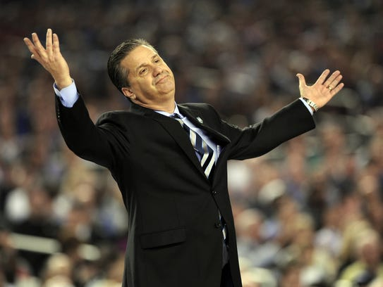Kentucky coach John Calipari doesn't know what to do about UConn as the Connecticut Huskies beat the Kentucky Wildcats 60-54 in the NCAA Final Four championship game at AT&T Stadium in Arlington, Texas, Monday, April 7, 2014. (Stephen Dunn/Hartford Courant/MCT)