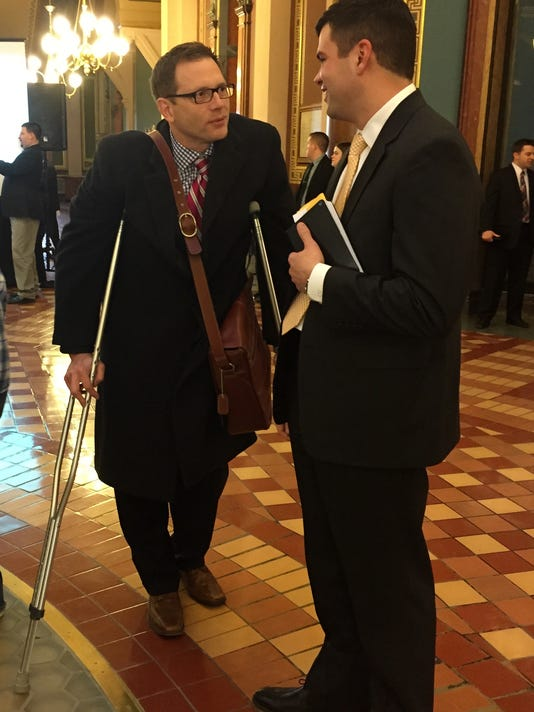 Dave Price, crutches, with Jimmy Centers,.jpg