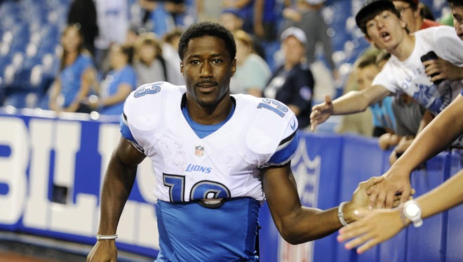 In this Aug. 29, 2013 file photo, Detroit Lions wide receiver  Nate Burleson (13) walks away from fans after signing autographs after an NFL football game against the Buffalo Bills in Orchard Park, N.Y.