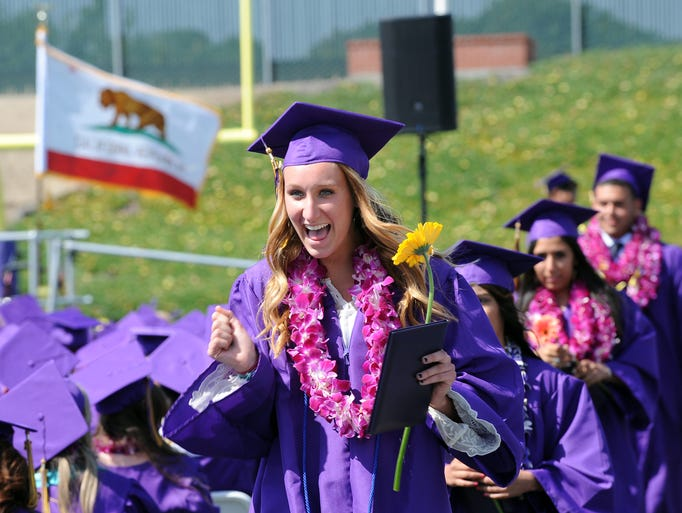 A very happy grad's smile says it all at Salinas High School's 2014 commencement ceremony on Thursday in Salinas.