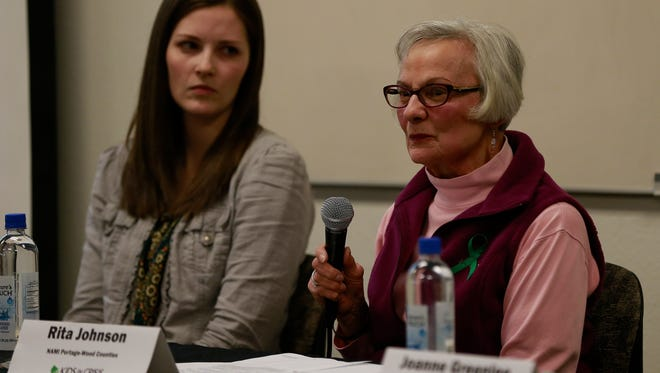 Panelists Rita Johnson, right, speaks about the community mentally illness and concerns while Ashley Normington looks on Thursday's Kids in Crisis town hall held at Mid-State Technical College in Marshfield, Wisc. T'xer Zhon Kha/USA TODAY NETWORK-Wisconsin