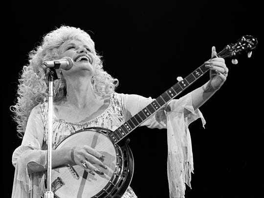 "Dolly Parton performs ""Applejack"" for the crowd at Murphy Center on the campus of Middle Tennessee State University in Murfreesboro Nov. 1, 1986. She was co-billed with Kenny Rogers, along with newcomer T. Graham Brown."