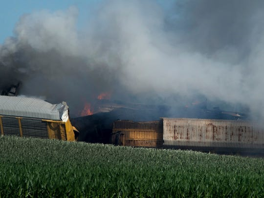 Derailed CSX train cars continue to burn before 9 a.m.,