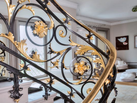 A detail on the original entry foyer balustrade.