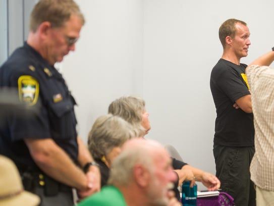 Rising Tide protester Henry Harris of Peacham speaks