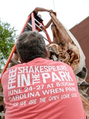 Brian Speed, below, helps Rob Home-Drummond set up a backdrop during a technical rehearsal for The Taming of the Shrew for the upcoming Shakespeare in the Park at Carolina Wren Park on Monday. The play is set in the 1920's with a New York accent, said Director David Larson.