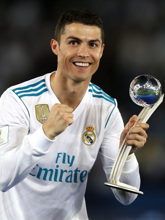 6fe7de47e GTY 893914012 S SPO SOC FOC ARE. Cristiano Ronaldo celebrates with his  adidas Golden Ball trophy after the FIFA Club World Cup.