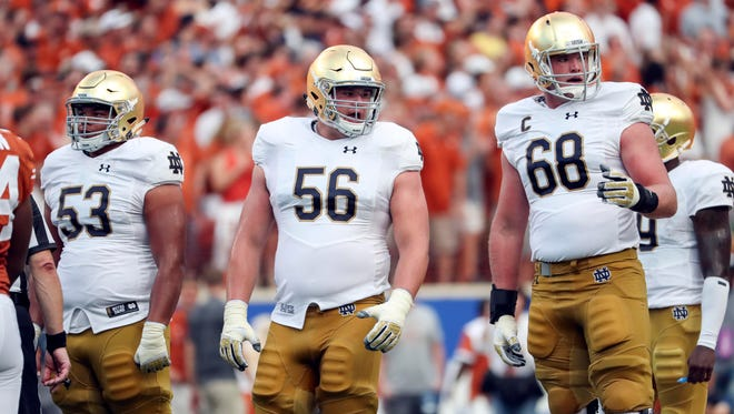 Sep 4, 2016; Austin, TX, USA; Notre Dame Fighting Irish offensive lineman Sam Mustipher (53) and offensive lineman Quenton Nelson (56) and offensive lineman Mike McGlinchey (68) during the game against the Texas Longhorns at Darrell K Royal-Texas Memorial Stadium. Mandatory Credit: Kevin Jairaj-USA TODAY Sports