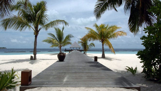This file photo taken on Aug. 17, 2007 shows the wooden entrance leading to the Coco Palm resort on Boduhithi Island in the Maldives.