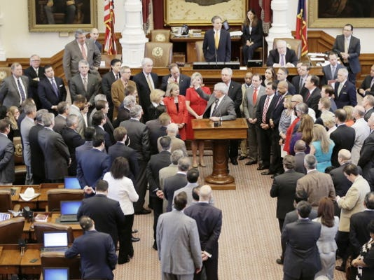 Texas Rep. Jimmie Don Aycock, R-Killeen, at podium, announces his retirement on the final day of the 84th Legislature.