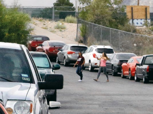Cars line both sides of El Puente Drive on Monday in the West Side neighborhood that is about one block from Coronado High School. Residents are concerned that students are taking up residential parking and blocking driveways, and are asking El Paso City Council to implement parking restrictions.