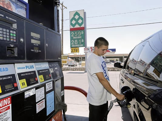 Devandro Montoya 15, fills up his mothers van at the Diamond Shamrock convenience store located at 511 N. Copia Street Friday afternoon where a gallon of regular gas was at 2.59 a gallon. According to GasBuddy.com this location had the cheapest price on a gallon of regular gasoline on Friday.