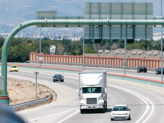 Vehicles travel along the César Chávez Border Highway on Monday.