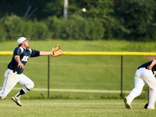 Glen Rock's Scott Merkel makes a running catch during a Central League baseball game in Glen Rock on July 7. Glen Rock beat Pleasureville, 6-0.