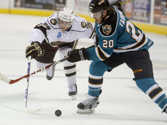 Hershey's Jakub Vrana chases down Worcester's Matt Taormina during Game 3 of their Calder Cup first-round series Wednesday at Giant Center. The Sharks won, 4-1, to avoid being swept in the series. The Bears take a 2-1 series lead into Friday's Game 4.