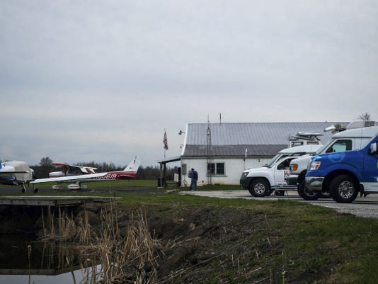 Media vans wait at Gettysburg Regional Airport on April 15.