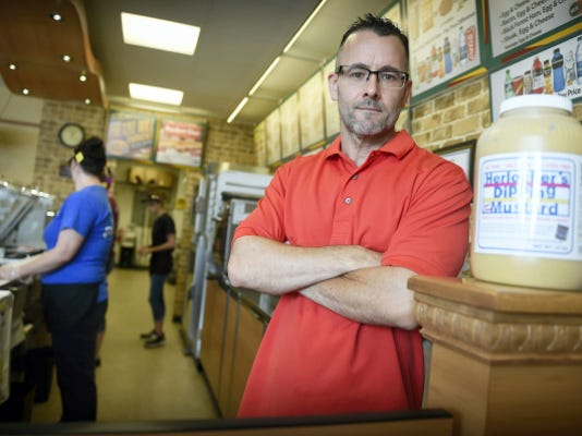 Owner of the Jonestown Subway Mike Dengler is proud of his staff after winning top honors. Lebanon County's Jonestown Subway took home the honors when they were chosen by corporate to preview the test sandwich, the Pretzel Roll. The staff of the Subway, 185 S Lancaster, Jonestown, promoted the newest meal so well they took home top selling honors. The Round Pretzel Bun, produced in Pennsylvania, holds ham or turkey, swiss cheese, and topped with Herlocher's dipping mustard. Michael K. Dakota - Lebanon Daily News