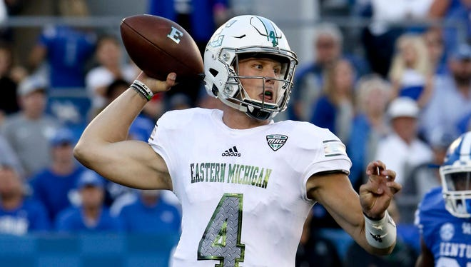 Eastern Michigan quarterback Brogan Roback (4) passes the ball against Kentucky In the second half at Commonwealth Stadium on Saturday, Sept. 30, 2017. Kentucky defeated Eastern Michigan 24-20.