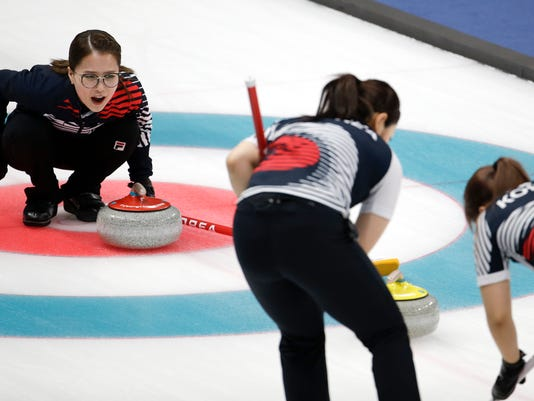 South Korea's skip Kim Eunjung makes a call during a women's semi-final curling match against Japan at the 2018 Winter Olympics in Gangneung, South Korea, Friday, Feb. 23, 2018. (AP Photo/Natacha Pisarenko)