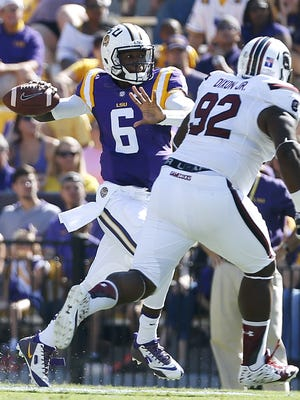 LSU quarterback Brandon Harris (6) throws the ball past South Carolina defensive tackle Gerald Dixon Jr. (92) during the first half of an NCAA college football game in Baton Rouge, La., Saturday, Oct. 10, 2015. LSU won 45-24. (AP Photo/Jonathan Bachman)