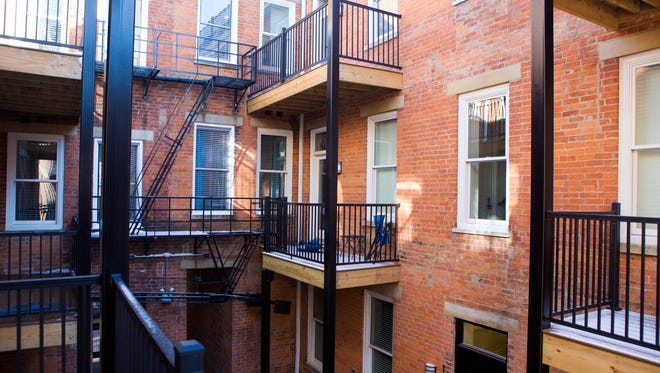The 12-unit Hogan apartments on Republic Street have access to a courtyard.