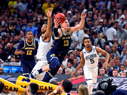 Michigan Wolverines forward Moritz Wagner (13) shoots the ball against Villanova Wildcats forward Omari Spellman (14) during the second half in the championship game of the 2018 men's Final Four at Alamodome.
